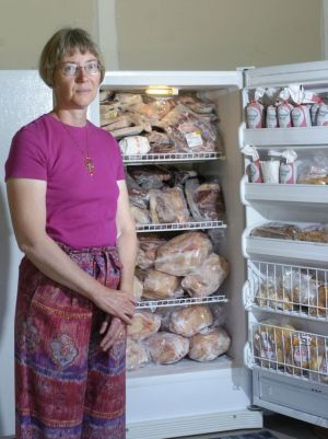 "Kathy Rafter stores quarter side of beef, lamb and chicken that she buys in bulk from a green livestock farm in her freezer. Rafter ""cowpools,""  or buys the beef from a cow with other people. (Lori Niedenfuer Cool 