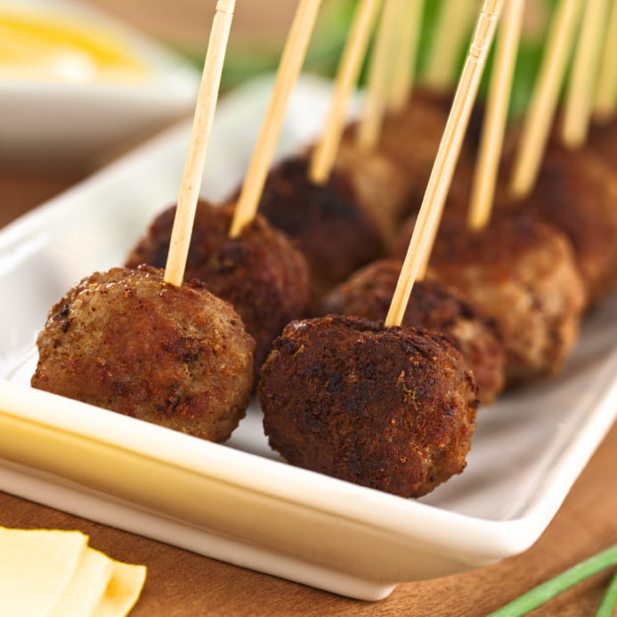 Meatball appetizers with toothpicks (Selective Focus, Focus on the first two meatballs)